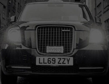 electric black cab parked in manchester